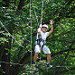 High Ropes-kid waves while walking on wire