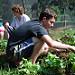 Gardening-boy works in garden